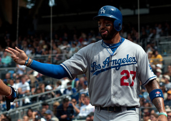 SAN DIEGO, CA - SEPTEMBER 25: Matt Kemp #27 of the Los Angeles Dodgers celebrates after scoring a run in the 5th inning of the game against the San Diego Padres at Petco Park on September 25, 2011 in San Diego, California. (Photo by Kent C. Horner/Getty I