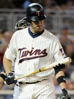 MINNEAPOLIS, MN - SEPTEMBER 6: Joe Mauer #7 of the Minnesota Twins reacts to striking out against the Chicago White Sox in the eighth inning on September 6, 2011 at Target Field in Minneapolis, Minnesota. The White Sox defeated the Twins 3-0. (Photo by Ha