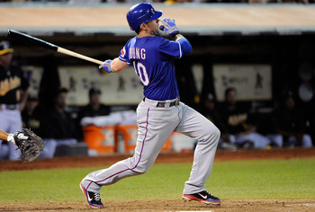 OAKLAND, CA - SEPTEMBER 20: Michael Young #10 of the Texas Rangers hits an RBI single against the Oakland Athletics in the eighth inning during an MLB baseball game at O.co Coliseum on September 20, 2011 in Oakland, California.  (Photo by Thearon W. Hende