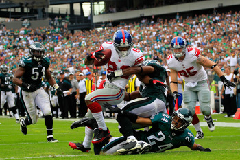 PHILADELPHIA, PA - SEPTEMBER 25:  Victor Cruz #80 of the New York Giants catches a 28 yard touchdown pass in the fourth quarter over Nnamdi Asomugha #24  and Jarrad Page #41 of the Philadelphia Eagles at Lincoln Financial Field on September 25, 2011 in Ph