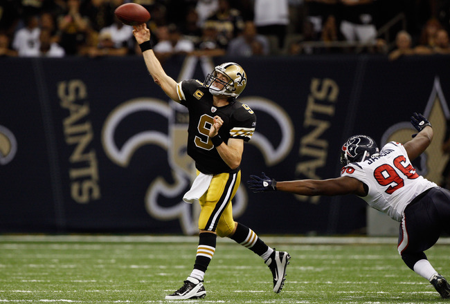 NEW ORLEANS, LA - SEPTEMBER 25:  Drew Brees #9 of the New Orleans Saints throws a pass during the game against the Houston Texans at the Louisiana Superdome on September 25, 2011 in New Orleans, Louisiana.  (Photo by Chris Graythen/Getty Images)