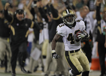GREEN BAY, WI - SEPTEMBER 08: Darren Sproles #43 of the New Orleans Saints looks up at the replay board as he runs back a punt for a touchdown against the Green Bay Packers during the NFL opening season game at Lambeau Field on September 8, 2011 in Green