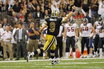 NEW ORLEANS, LA - SEPTEMBER 25:  Drew Brees #9 of the New Orleans Saints celebrates after throwing a touchdown pass against the Houston Texans at the Louisiana Superdome on September 25, 2011 in New Orleans, Louisiana.  (Photo by Chris Graythen/Getty Imag