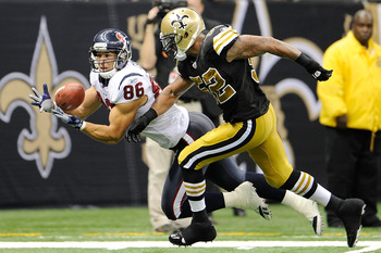 NEW ORLEANS, LA - SEPTEMBER 25:  Jonathan Casillas #52 of the New Orleans Saints is unable to defend a touchdown pass to James Casey #86 of the Houston Texans during a game being held at the Louisiana Superdome on September 25, 2011 in New Orleans, Louisi