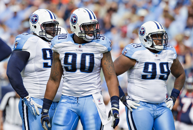 NASHVILLE, TN - SEPTEMBER 25:  Derrick Morgan #90, Jurrell Casey #99 and Shaun Smith #93 of the Tennessee Titans defense wait for the offense of the Denver Broncos at LP Field on September 25, 2011 in Nashville, Tennessee.   The Titans defeated the Bronco
