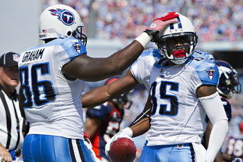 NASHVILLE, TN - SEPTEMBER 25:  Nate Washington #85 celebrates with Daniel Graham #86 of the Tennessee Titans after scoring a touchdown against the Denver Broncos at LP Field on September 25, 2011 in Nashville, Tennessee.   The Titans defeated the Broncos