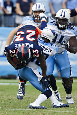 NASHVILLE, TN - SEPTEMBER 25:  Willis McGahee #23 of the Denver Broncos is tackled by Jason McCourty #30 of the Tennessee Titans at LP Field on September 25, 2011 in Nashville, Tennessee.   The Titans defeated the Broncos 17 - 14.  (Photo by Wesley Hitt/G