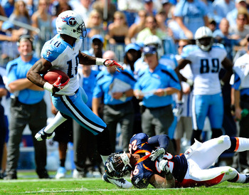 NASHVILLE, TN - SEPTEMBER 25:  Kenny Britt #18 of the Tennessee Titans spins out of a tackle by Rahim Moore #26 of the Denver Broncos  during the first half at LP Field on September 25, 2011 in Nashville, Tennessee.  (Photo by Grant Halverson/Getty Images