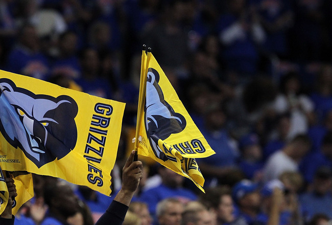 OKLAHOMA CITY, OK - MAY 15:  Fans of the Memphis Grizzlies waves flags against the Oklahoma City Thunder in Game Seven of the Western Conference Semifinals in the 2011 NBA Playoffs on May 15, 2011 at Oklahoma City Arena in Oklahoma City, Oklahoma.  NOTE T