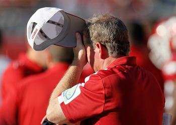 TUSCALOOSA, AL - SEPTEMBER 24:  Head coach Bobby Petrino of the Arkansas Razorbacks wipes his forehead during the game against the Alabama Crimson Tide at Bryant-Denny Stadium on September 24, 2011 in Tuscaloosa, Alabama.  (Photo by Kevin C. Cox/Getty Ima