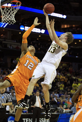 CHARLOTTE, NC - MARCH 18:  Matt Vogrich #13 of the Michigan Wolverines shoots over Tobias Harris #12 of the Tennessee Volunteers in the first half during the second round of the 2011 NCAA men's basketball tournament at Time Warner Cable Arena on March 18,