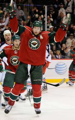 ST PAUL, MN - SEPTEMBER 23: Dany Heatley #15 of the Minnesota Wild celebrates scoring the game-winning goal against the Columbus Blue Jackets in overtime on September 23, 2011 at Xcel Energy Center in Minneapolis, Minnesota. The Wild defeated the Blue Jac