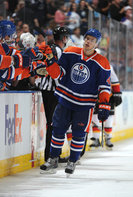 EDMONTON, CANADA - SEPTEMBER 24: Taylor Hall #4 of the Edmonton Oilers celebrates his game winning goal against the Calgary Flames during third period action on September 24, 2011 at the Rexall Place in Edmonton, Alberta, Canada. (Photo by Dale MacMillan/