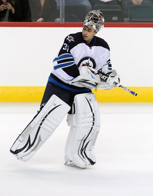 WINNIPEG, CANADA - SEPTEMBER 20: Ondrej Pavelec #31 of the Winnipeg Jets skates to his net during the NHL game against the Columbus Blue Jackets at the MTS Centre on September 20, 2011 in Winnipeg, Manitoba, Canada. (Photo by Marianne Helm/Getty Images)