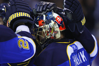 ST. LOUIS, MO - APRIL 5: Jaroslav Halak #41 of the St. Louis Blues is congratulated by teammates after beating the Colorado Avalanche at the Scottrade Center on April 5, 2011 in St. Louis, Missouri.  (Photo by Dilip Vishwanat/Getty Images)
