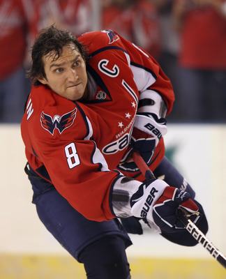 BALTIMORE, MD - SEPTEMBER 20:  Alex Ovechkin #8 of the Washington Capitals skates in warmups prior to the game against the Nashville Predators at the 1st Mariner Arena on September 20, 2011 in Baltimore, Maryland. The Predators defeated the Capitals 2-0.