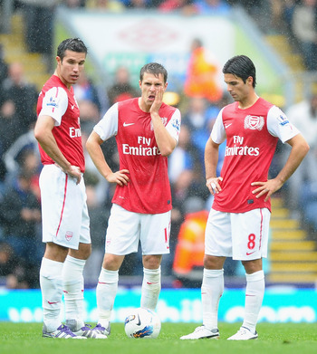 BLACKBURN, ENGLAND - SEPTEMBER 17:  l-r Robin Van Persie, Aaron Ramsey and Mikel Arteta of Arsenal show their dissapointment after the fourth goal during the Barclays Premier League match between Blackburn Rovers and Arsenal at Ewood Park on September 17,