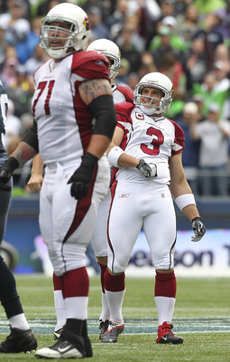 SEATTLE - SEPTEMBER 25:  Kicker Jay Feely #3 of the Arizona Cardinals watches the flight of a missed 51 yard field goal in the first quarter against the Seattle Seahawks at CenturyLink Field on September 25, 2011 in Seattle, Washington. The Seahawks defea