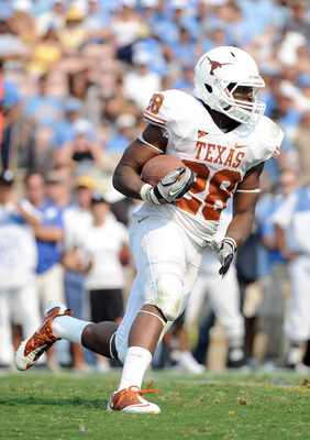PASADENA, CA - SEPTEMBER 17:  Malcolm Brown #28 of the Texas Longhorns takes a handoff against the UCLA Bruins at Rose Bowl on September 17, 2011 in Pasadena, California.  (Photo by Harry How/Getty Images)