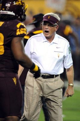 TEMPE, AZ - SEPTEMBER 24:  Head Coach Dennis Erickson of the Arizona State Sun Devils pumps up his team during pregame warmups against the University of Southern California Trojans at Sun Devil Stadium on September 24, 2011 in Tempe, Arizona.  (Photo by N