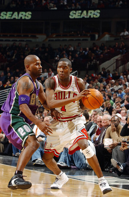 CHICAGO - DECEMBER 1:  Jamal Crawford #1 of the Chicago Bulls drives on Erick Strickland #20 of the Milwaukee Bucks on December 1, 2003 at the United Center in Chicago, Illinois. The Bulls won 97-87. NOTE TO USER: User expressly acknowledges and agrees th