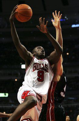 CHICAGO - DECEMBER 27:  Loul Deng #9 of the Chicago Bulls puts up a shot over Michael Doleac #51 of the Miami Heat on December 27, 2006 at the United Center in Chicago, Illinois. The Bulls defeated the Heat 109-103. NOTE TO USER: User expressly acknowledg
