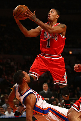 NEW YORK - DECEMBER 22:  Derrick Rose #1 of the Chicago Bulls charges into Jared Jeffries #20 of the New York Knicks at Madison Square Garden on December 22, 2009 in New York City. NOTE TO USER: User expressly acknowledges and agrees that, by downloading