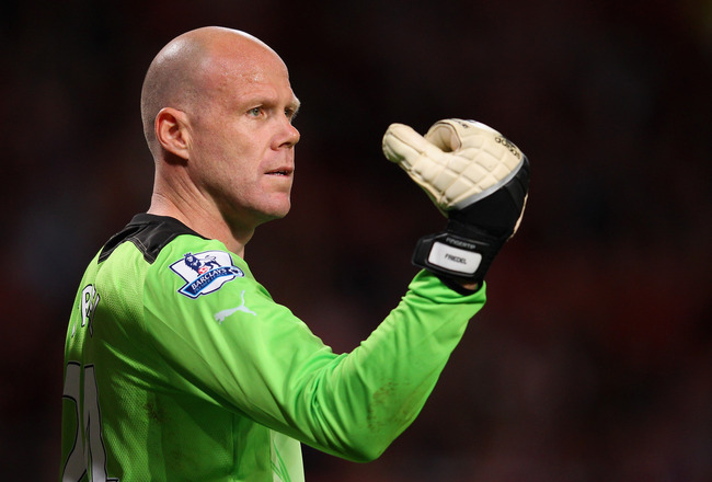 MANCHESTER, ENGLAND - AUGUST 22:  Brad Friedel of Tottenham Hotspur directs his defence during the Barclays Premier League match between Manchester United and Tottenham Hotspur at Old Trafford on August 22, 2011 in Manchester, England.  (Photo by Alex Liv