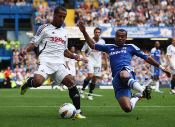 LONDON, ENGLAND - SEPTEMBER 24:  Ashley Cole of Chelsea tackles Scott Sinclair of Swansea City during the Barclays Premier League match between Chelsea and Swansea City at Stamford Bridge on September 24, 2011 in London, England.  (Photo by Clive Rose/Get