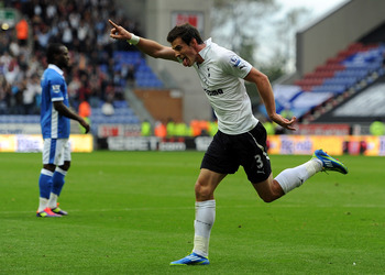 WIGAN, ENGLAND - SEPTEMBER 24:  Gareth Bale of Tottenham Hotspur celebrates scoring his side's second goal during the Barclays Premier League match between Wigan Athletic and Tottenham Hotspur at DW Stadium on September 24, 2011 in Wigan, England.  (Photo