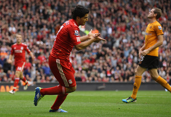 LIVERPOOL, ENGLAND - SEPTEMBER 24:  Luis Suarez of Liverpool celebrates scoring the second goal during the Barclays Premier League match between Liverpool and Wolverhampton Wanderers at Anfield on September 24, 2011 in Liverpool, England.  (Photo by Clive