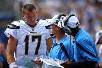 SAN DIEGO, CA - SEPTEMBER 25:   Quarterback Philip Rivers #17 of the San Diego Chargers looks at pictures on the sidelines against the Kansas City Chiefs during their NFL Game on September 25, 2011 at Qualcomm Stadium in San DIego, California. (Photo by D