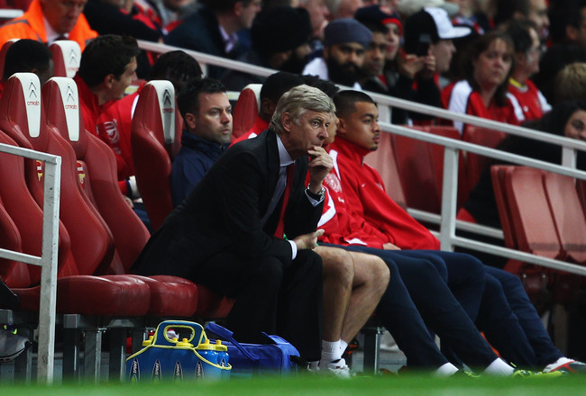 LONDON, ENGLAND - SEPTEMBER 20:  Arsene Wenger manager of Arsenal looks thoughtful as he sits on the bench during the Carling Cup Third Round match between Arsenal and Shrewsbury Town at Emirates Stadium on September 20, 2011 in London, England.  (Photo b