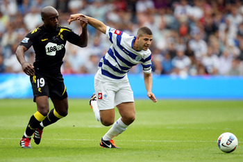 LONDON, ENGLAND - AUGUST 13:  Nigel Reo-Coker of Bolton clashes with Adel Taarabt of Queens Park Rangers during the Barclays Premier League match between Queens Park Rangers and Bolton Wanderers at Loftus Road on August 13, 2011 in London, England.  (Phot