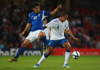 LONDON, ENGLAND - SEPTEMBER 01:  Jack Rodwell of England battles for the ball with Eshgin Guliyev of Azerbaijan during the UEFA European Under-21 Championship Qualifier Group 8 match between England and Azerbaijan at Vicarage Road on September 1, 2011 in