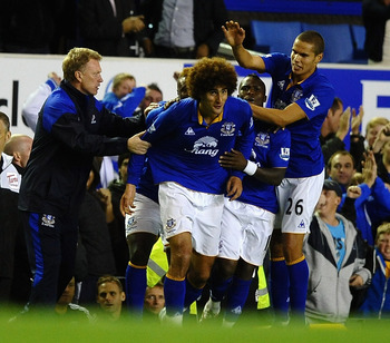 LIVERPOOL, ENGLAND - SEPTEMBER 21: Marouane Fellaini of Everton celebrates scoring the equalising goal with Jack Rodwell and David Moyes during the Carling Cup Third Round match between Everton and West Bromwich Albion at Goodison Park on September 21, 20