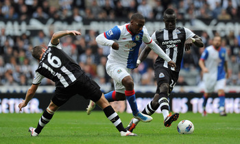 NEWCASTLE UPON TYNE, ENGLAND - SEPTEMBER 24:  David Hoilett (C) of Blackburn gets through the challenge of Ryan Taylor (L) and Cheik Tiote of Newcastle during the Barclays Premier League match between Newcastle United and Blackburn Rovers at St James' Par