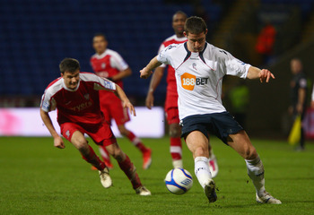 BOLTON, ENGLAND - JANUARY 08: Gary Cahill of Bolton Wanderers clears the ball away from Jonathan Smith of York City during the F.A Cup sponsored by E.ON 3rd round match between Bolton Wanderers and York City at Reebok Stadium on January 8, 2011 in Bolton,