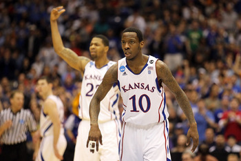 SAN ANTONIO, TX - MARCH 27:  Tyshawn Taylor #10 and Marcus Morris #22 of the Kansas Jayhawks react during the southwest regional final of the 2011 NCAA men's basketball tournament against the Virginia Commonwealth Rams at the Alamodome on March 27, 2011 i