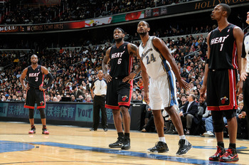 WASHINGTON, DC - DECEMBER 18:  LeBron James #6, Dwyane Wade #3 and Chris Bosh #1 of the Miami Heat and Hilton Armstrong #24 of the Washington Wizards wait for a free throw attempt at the Verizon Center on December 18, 2010 in Washington, DC. NOTE TO USER: