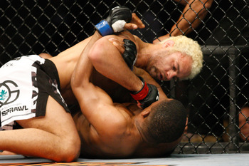 MONTREAL- MAY 8: Josh Koscheck (top) punches Paul Daley in their welter weight bout at UFC 113 at Bell Centre on May 8, 2010 in Montreal, Quebec, Canada.  (Photo by Richard Wolowicz/Getty Images)