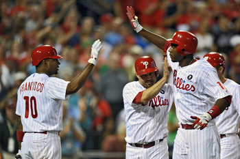 PHILADELPHIA, PA - AUGUST 23: John Mayberry Jr. #15 of the Philadelphia Phillies is congratulated by teammates Ben Francisco #10 and Placido Polanco #27 after hitting a three run home run in the third inning during the game against the New York Mets at Ci