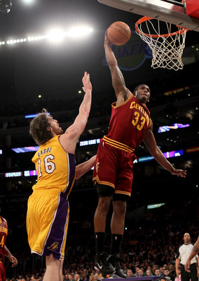 LOS ANGELES, CA - JANUARY 11:  Alonzo Gee #33 of the Cleveland Cavaliers dunks over Pau Gasol #16 of the Los Angeles Lakers at Staples Center on January 11, 2011 in Los Angeles, California.  The Lakers won 112-57.  NOTE TO USER: User expressly acknowledge