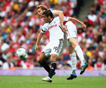 LONDON, ENGLAND - SEPTEMBER 10:  Per Mertesacker of Arsenal battles with Danny Graham of Swansea City during the Barclays Premier League match between Arsenal and Swansea City at Emirates Stadium on September 10, 2011 in London, England.  (Photo by Clive