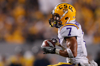 MORGANTOWN, WV - SEPTEMBER 24: Tyrann Mathieu #7 of the Louisiana State University Tigers intercepts a pass against the West Virginia Mountaineers during the game on September 24, 2011 at Mountaineer Field in Morgantown, West Virginia.  (Photo by Jared Wi