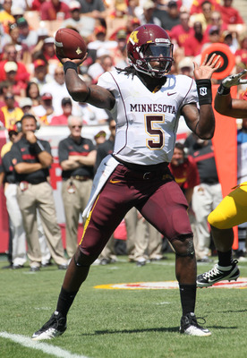 LOS ANGELES, CA - SEPTEMBER 03:  Quarterback MarQueis Gray #5 of the Minnesota Golden Gophers throws a pass against the USC Trojans at the Los Angeles Memorial Coliseum on September 3, 2011 in Los Angeles, California. USC won 19-17.  (Photo by Stephen Dun