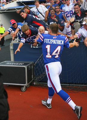 ORCHARD PARK, NY - SEPTEMBER 25:  Ryan Fitzpatrick #14 of the Buffalo Bills celebrates with fans after defeating  the New England Patriots at Ralph Wilson Stadium on September 25, 2011 in Orchard Park, New York. Buffalo won 34-31.  (Photo by Rick Stewart/