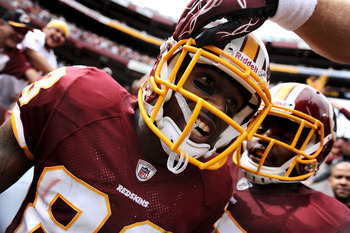 LANDOVER, MD - SEPTEMBER 18: Tight end Fred Davis #83 of the Washington Redskins celebrates after a touchdown against the Arizona Cardinals during the second quarter at FedExField on September 18, 2011 in Landover, Maryland. (Photo by Patrick Smith/Getty