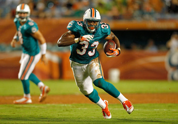 MIAMI GARDENS, FL - SEPTEMBER 01:   Daniel Thomas #33 of the Miami Dolphins runs with the ball during a Pre-Season NFL game against the Dallas Cowboys at Sun Life Stadium on September 1, 2011 in Miami Gardens, Florida.  (Photo by Mike Ehrmann/Getty Images