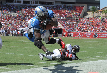 TAMPA, FL - SEPTEMBER 11:  Wide receiver Nate Burleson #13 of the Detroit Lions dives toward the endzone during the season opener against the Tampa Bay Buccaneers at Raymond James Stadium September 11, 2011 in Tampa, Florida. (Photo by Al Messerschmidt/Ge